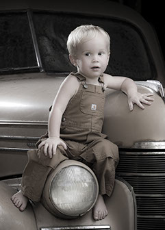 Tuscaloosa, Alabama photographer's picture of a little boy in overalls on an antique car.