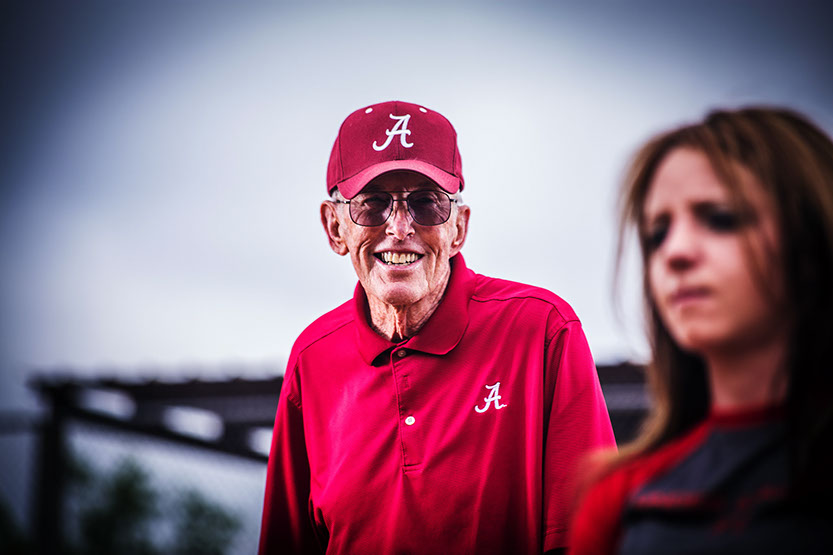 Alabama ASA Hall of Fame member coaches a girls softball player taken by a Tuscaloosa Photographer.