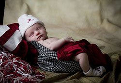 A Roll Tide kind of a picture. A baby in a houndstooth hat taken by a Tuscaloosa photographer.