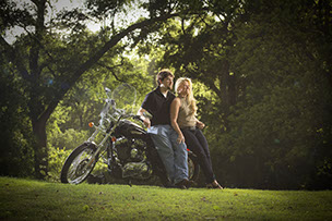 Tuscaloosa, Alabama engagement photography at Capitol Park. Bride and Groom with a Harley Davidson motorcycle.