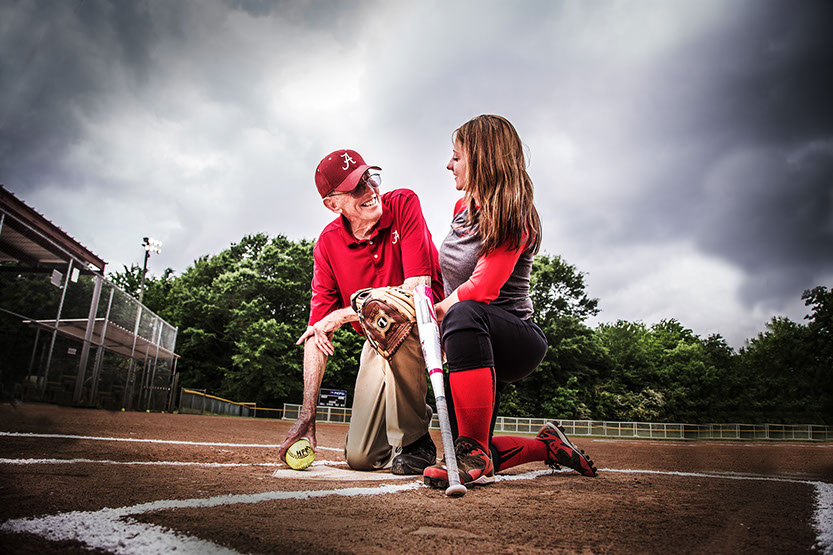 Tuscaloosa, Alabama softball coach Paul Morrison with one of the girls softball players he coached.  Taken by a Tuscaloosa photographer..