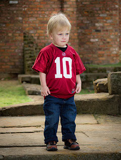 Little boy in Alabama Crimson Tide jersey. Roll Tide! Taken by photographer in Tuscaloosa, Alabama.