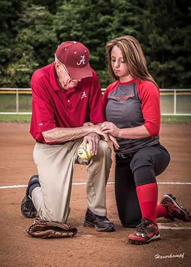 Picture of Tuscaloosa, Alabama softball coach with a girls softball player. Taken by a Tuscaloosa photographer.