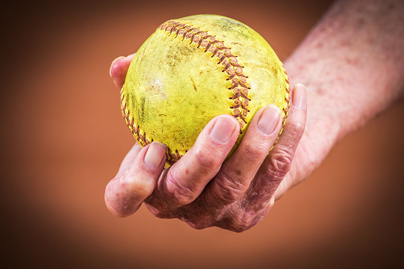 Softball in the hand of a Tuscaloosa, Alabama Softball coach. Taken by a Tuscaloosa photographer.