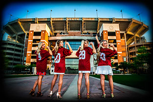 Four University Of Alabama graduates at the Walk of Champions at Bryant-Denny Stadium on campus. graduation pictures
